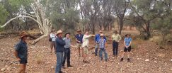 (L) Hugh Pringle (centre, pointing) on Mt Augustus group discussing suspension filter placement filters as a tool to slow the water higher in the landscape before it hits the high grazing value flood out plains, (K.Watson)