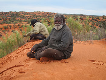 Mr Byron Brooks and Troy Hansen on the sand dune at Miramiratjara (Spinifex Country) during the third Healthy Country Planning on country trip (August 2015).